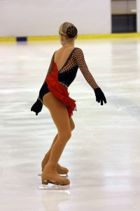 IceSkating skater entering jump
