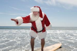Santa Claus Surfing On Beach